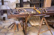 Vintage woodworking tools on a wooden workbench Stock Photos