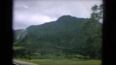 1964: beautiful green vistas driving through the mountains on a sunny day HAWAII Stock Footage