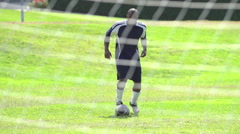 A man playing soccer on a grassy field. Stock Footage