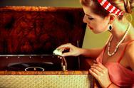 Girl in style keeps vinyl record. Stock Photos