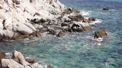 Seascape and rocks shore, beautiful turquoise sea on the summer day. Stock Footage