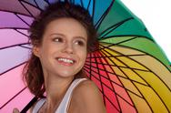 Smiling young brunette woman in white blouse with umbrella Stock Photos