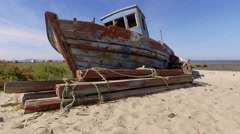 Old fishing boat abandoned steady shot 4k Stock Footage