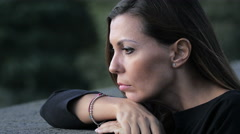 Attractive young woman alone with its problems: sad and melancholic woman Stock Footage
