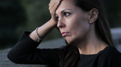 Pensive and sad woman is about to cry: lonely woman lost in problems Stock Footage