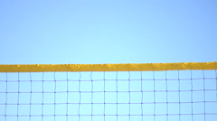A man spiking a beach volleyball. Stock Footage