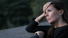 Young Sad and thoughtful Woman In The City: tired woman, depressed woman Stock Footage