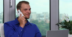 Confident Good Looking Business Man Talking Mobile Phone Pan Left Camera Office Stock Footage
