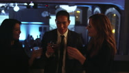 Friends in the balcony of a nightclub toast their drinks and start dancing Stock Footage