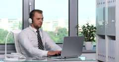 Charming Business Man Listening Music Browsing Internet Laptop Office Room Desk Stock Footage