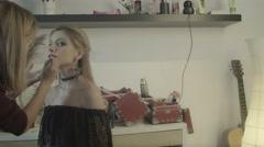 Makeup artist applies lipstick. Beautiful woman face. Perfect makeup Stock Footage