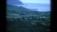 1964: enjoying the beautiful scenery from atop of a mountain to see the valley Stock Footage