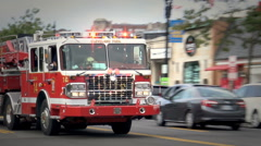 Ladder truck followed by Rescue Truck, sirens, DC Stock Footage