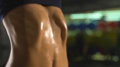 Close-up sweaty torso of girl pulls up on bar Stock Footage