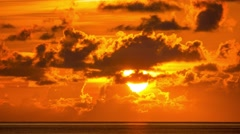 Dramatic beautiful sunrise over ocean. 4K UHD Timelapse. Stock Footage