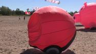Fun Pokemon Go kites on the beach Stock Footage
