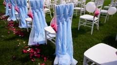 Wedding ceremony in the open countryside. All decorated with blue fabrics and Stock Footage