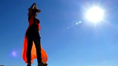 Girl Takes Off Cowboy Hat in Slow Motion. She Standing on the Sun Light. Stock Footage