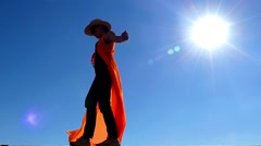Girl in Cowboy and Cloak Hat Stands in Sun Light on the Wind. Slow Motion. Stock Footage