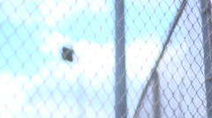 Chain-link fence surrounding a basketball court. Stock Footage