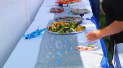 Table in the courtyard fruit vegetables meat Stock Footage