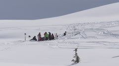 A group of men helicopter skiing on a snow covered mountain. Stock Footage