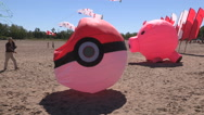Fun Pokemon Go kites on the beach Stock Footage