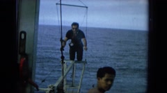 1964: man,black shirt and pants getting up from knees while trying to balance  Stock Footage