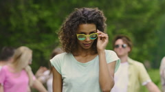 Dreamy girl with curly hair putting sunglasses on, flirting with camera, dancing Stock Footage