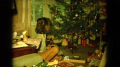 1964: my nanny for christmas give us a little puppy and we were so happy.  Stock Footage