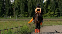 Woman Rider Sitting on the Brown Horse and Horse Walking. Stock Footage