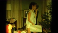 1964: kids busy with decorating the x-mas tree in the room HAWAII Stock Footage