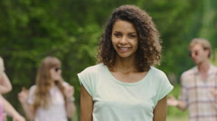Young lady with white teeth, perfect skin smiling, dancing with friends at party Stock Footage