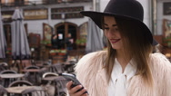 Cell phone - woman talking on smartphone in city Stock Footage