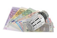 Energy saving concept with thermostat and money,  3D rendering Piirros