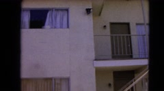 1966: apartment building made of white stone with a staircase BARSTOW Stock Footage