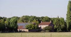 Solar pv panels on farm roof Stock Footage