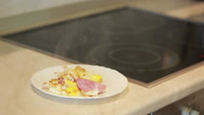 Fried eggs and ham in a pan for breakfast. Cooking Stock Footage