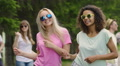 Couple of hot girls dancing with friends at open air festival, enjoying summer HD Footage