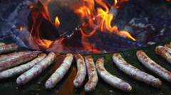 Chef grilling and flipping a Sausage with flames Stock Footage