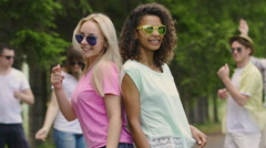 Girls band dancing for music video, young attractive people enjoying summertime Stock Footage