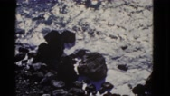 1952: the white frothy sea kissing the black rocky shore INTERNATIONAL WATERS Stock Footage