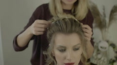 Hairstyle,hairdresser's hands to work on client's hair at salon Stock Footage