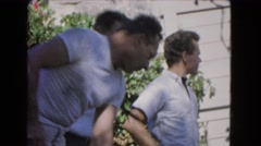 1966: several young men outdoors who appear to be shoveling or raking CATALINA Stock Footage