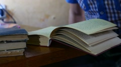 Man reading an old book education close-up turns the page video Stock Footage