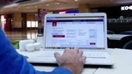 Shopping online on Emirates airlines website.  Stock Footage