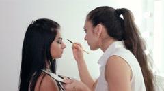 Make-up artist applying makeup Stock Footage