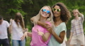 Two multiracial females happily dancing outdoors, young people enjoying party HD Footage