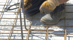 Hands of construction worker during he connects armature by Sheyno. Stock Footage