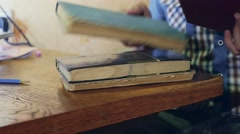 Man reading old book close-up turns the page education video Stock Footage